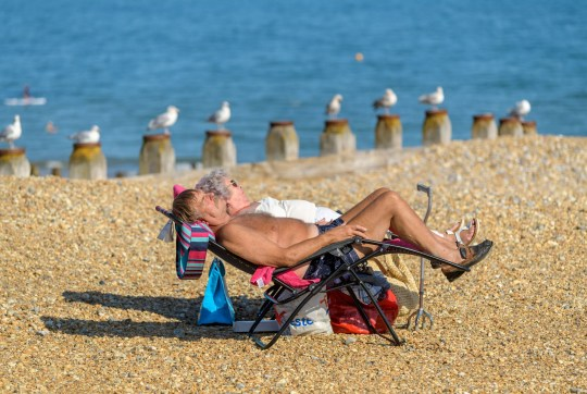Mandatory Credit: Photo by Jon Santa Cruz/REX/Shutterstock (10776487d) People take to the beach at Eastbourne as unusually high temperatures give rise to an Indian summer. Eastbourne, East Sussex, UK. Seasonal weather, Eastbourne, UK - 14 Sep 2020