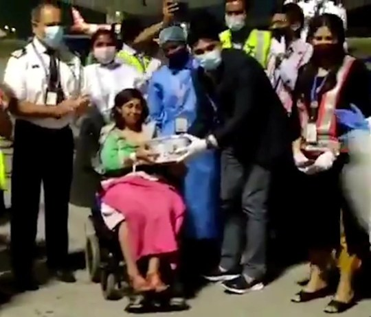A woman who has just given birth on a plane is met a crowd of cheering ground crew at Bengaluru airport. See SWNS story SWOCplane. A pregnant mum had a baby on a plane - delivered by a gynaecologist passenger. The woman went into labour on Indian airline IndiGo?s New Delhi-Bengaluru flight on October 7. Luckily, Dr Sailaja Vallabhaneni, a trained gynaecologist and obstetric surgeon was onboard the flight and helped deliver the baby. She has over thirteen years experience and is currently working at Cloud Nine hospitals. Video shows grand crews cheering as the flight that took off from northern India?s New Delhi and landed in southern India?s Bengaluru.