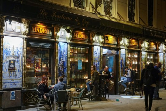 Customers sit at tables outside a bar at night in Madrid, Spain, on Thursday, Oct. 8, 2020. France, Spain and the Czech Republic posted record increases in coronavirus cases, underscoring growing alarm in Europe as it struggles to control the pandemic. Photographer: Paul Hanna/Bloomberg via Getty Images