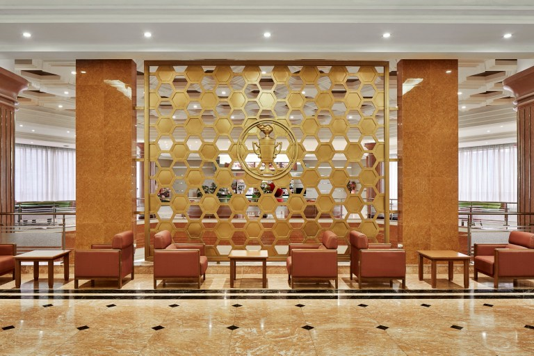 hotels of pyongyang book captures hotel interiors and staff in north korea's capital city: gold in lobby