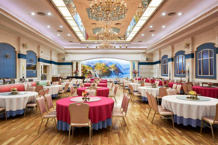 hotels of pyongyang book captures hotel interiors and staff in north korea's capital city: interiors dining room of pothogang hotel