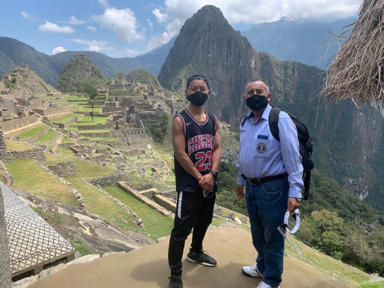Jesse Katayama and tour guide at Machu Picchu