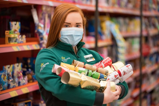 Customer Assistant, Jess, unveils Morrison's new Christmas range, as the supermarket has announced they have removed glitter entirely from its own-brand decorations, cards, wrapping paper and horticulture, which will reduce the plastic sold in store by more than 50 tonnes a year.