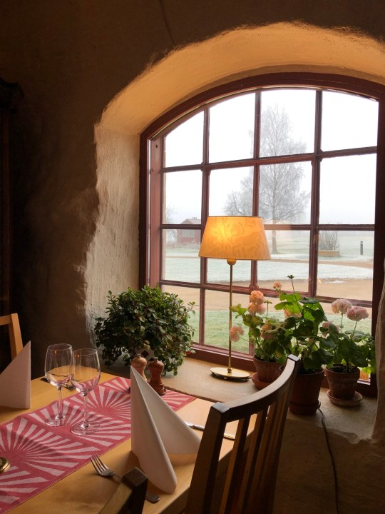 View of a dining table by a rustic window