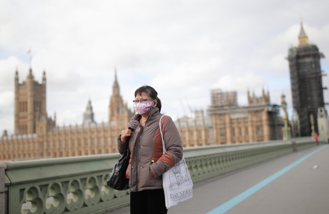 A woman in a face mask in London.