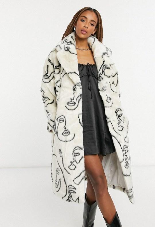 Jakke katie longline faux fur coat in abstract face print (Picture: Asos)