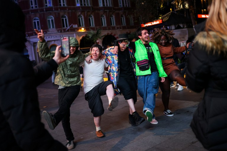 People dance and socialise in Soho, amid the outbreak of the coronavirus disease (COVID-19), in London, Britain October 16, 2020. REUTERS/Hannah McKay
