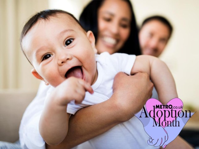 Parents holding their smiling baby with the Adoption Month logo.