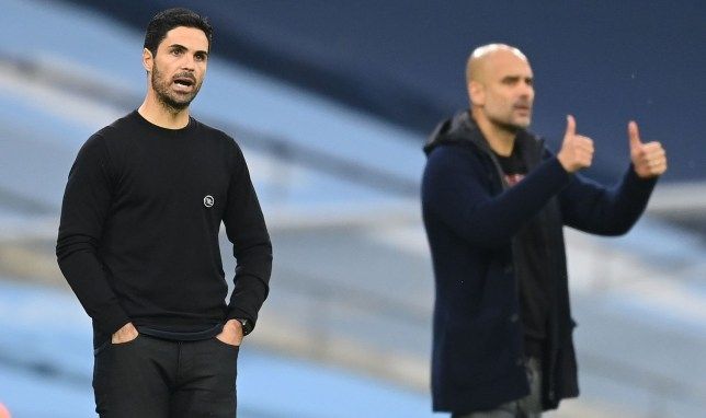 Arsenal's Spanish manager Mikel Arteta (L) and Manchester City's Spanish manager Pep Guardiola watch during the English Premier League football match between Manchester City and Arsenal at the Etihad Stadium in Manchester, north west England, on October 17, 2020. (Photo by Michael Regan / POOL / AFP) / RESTRICTED TO EDITORIAL USE. No use with unauthorized audio, video, data, fixture lists, club/league logos or 'live' services. Online in-match use limited to 120 images. An additional 40 images may be used in extra time. No video emulation. Social media in-match use limited to 120 images. An additional 40 images may be used in extra time. No use in betting publications, games or single club/league/player publications. / (Photo by MICHAEL REGAN/POOL/AFP via Getty Images)