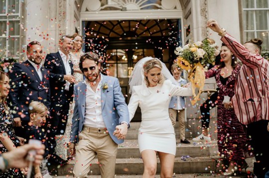 lauren maybank and robert on their wedding day in chelsea and kensington town hall