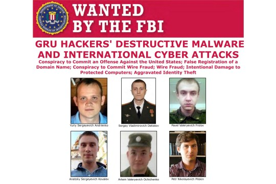 This image released by the FBI shows part of the wanted poster for six Russian military officers who sought to disrupt through computer hacking the French election, the Winter Olympics and U.S. businesses according to a Justice Department indictment unsealed Monday, Oct. 19, 2020, that details attacks on a broad range of political, financial and athletic targets. (FBI via AP)