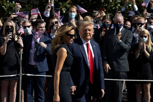 WASHINGTON, DC - OCTOBER 22: First Lady Melania Trump and President Donald Trump walk to the South Lawn to depart the White House on October 22, 2020 in Washington, DC. President Trump travels to Nashville, Tennessee for the final debate with Democratic presidential nominee Joe Biden. The Commission on Presidential Debates changed the format this time, muting of microphones to start each of Thursday's debate segments. (Photo by Tasos Katopodis/Getty Images) *** BESTPIX ***