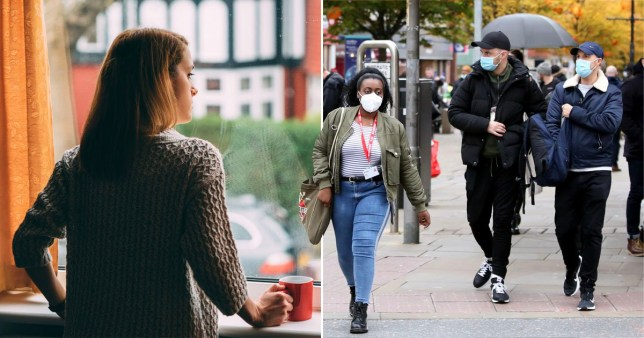 Woman looks out the window in isolation, people walk on road with face masks on