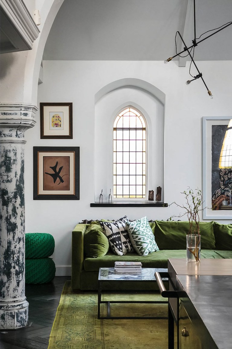 Story from Jam Press (Gothic Church Home) // Pictured: A breathtaking gothic church conversion that is up for sale in Kensal Green. // A spooky converted Gothic church has gone on sale just in time for Halloween // A spooky converted Gothic church has become available????? just in time for Halloween. The impressive property can be found in Kensal Green and has been transformed into a four-bedroom house with over 6,000 sq ft of space, available at ??5.95million. Following on with the ghostly theme, the property is but a hop, skip and a jump from Kensal Green Cemetery. Known as Kenmont Gardens, the former church has original features preserved throughout????? from elegant internal arches to gorgeous stained-glass windows. Additionally, at the northern end of the building, you can marvel at the conical-roofed turret which forms the entrance hall and bespoke bronze spiral staircase which leads to the galleried study above. The upper floor also features two bedrooms, each with en suite bathrooms and free-standing baths. Meanwhile, the master bedroom can be found on the second floor, accessed through a dressing area and with a vaulted ceiling and skylights providing ample natural light. There is also a nursery connected to the room. From the hall, make your way across the Italian-tiled floor to the pantry, reception space ??? which includes a custom-made kitchen by designer Rupert Bevan, dining and both formal and informal living areas ??? and the guest WC. The property might be old but it has modern finishes including blackened oak-parquet flooring that extends to the ground level, with underfloor heating. There is also a fireplace with a beautiful herringbone-brick back and honed-marble surround in the reception space to keep you warm????? which leads on to one of the guest bedrooms which features an en suite shower room and access to the garden. There is also a versatile room to the right, which is currently being used as a gym. The home is eerily quiet,