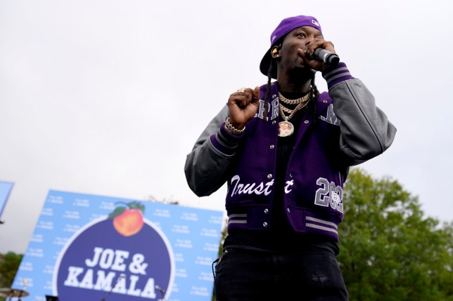 Rapper Offset performs before Democratic presidential candidate former Vice President Joe Biden arrives to speak at a drive-in rally at Cellairis Amphitheatre in Lakewood, Ga., Tuesday, Oct. 27, 2020. (AP Photo/Andrew Harnik)