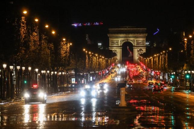 Cars driving through the Arc de Triomphe in Paris