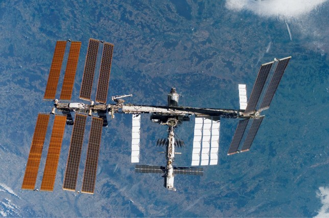 The ISS orbiting above Earth