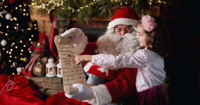 a child reading a letter with santa