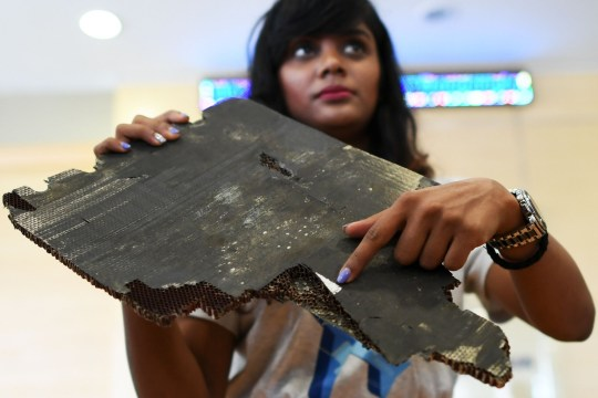 Grace Subathirai Nathan (R), daughter of Malaysian Airlines flight MH370 passenger Anne Daisy, shows a piece of debris believed to be from flight MH370 during a press conference in Putrajaya on November 30, 2018. - The Malaysia Airlines jet vanished in March 2014 while en route from Kuala Lumpur to Beijing with 239 people onboard, most of them from China. (Photo by Mohd RASFAN / AFP)MOHD RASFAN/AFP/Getty Images