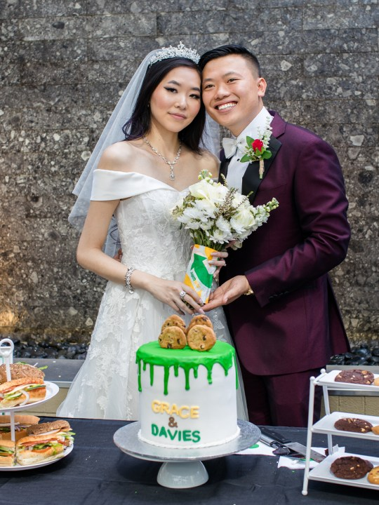 bride and groom on wedding day holding Subway bouquet