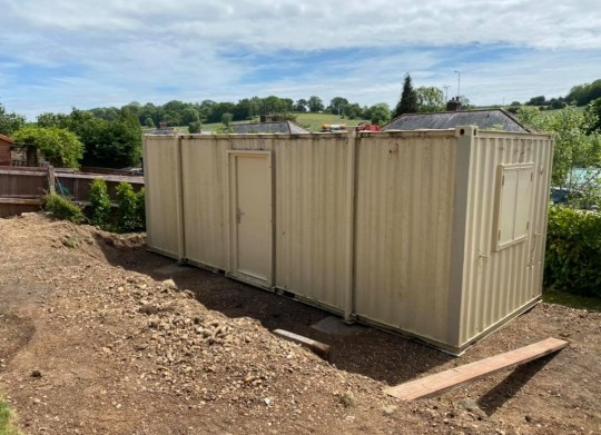 dawn groom's shipping container site cabin when it arrived
