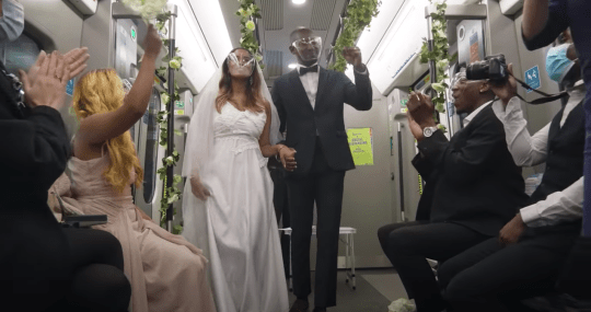 a picture of a prank wedding on a TFL train