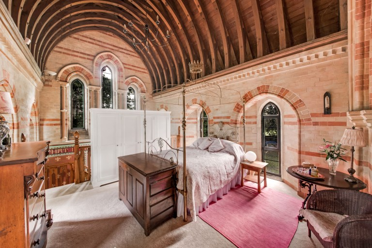 one of the bedrooms in the victorian church converted into a family home