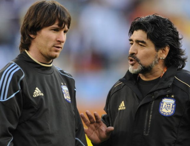 Lionel Messi chats with Argentina legend Diego Maradona