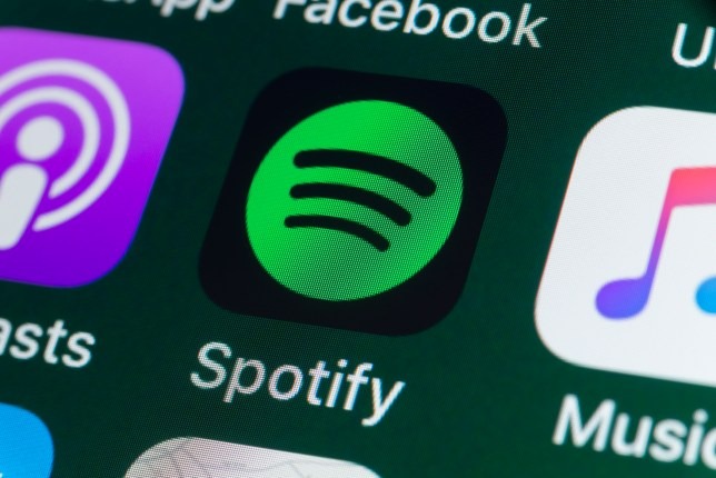 Spotify, Podcasts, Music and other Apps on iPhone screen.