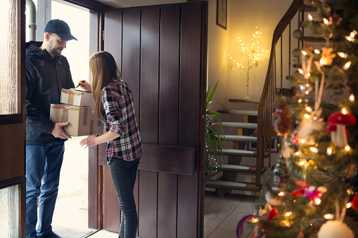 receiving Christmas packages delivered by postman