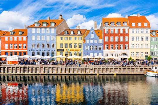 Multicolored houses along the canal in Nyhavn harbor, Copenhagen, Denmark