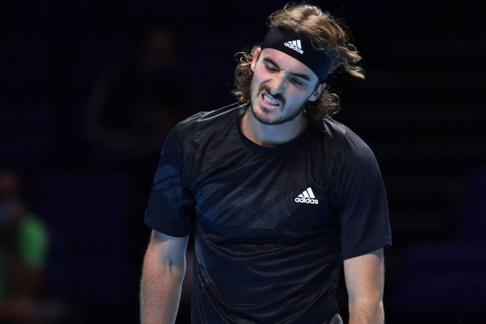 Greece's Stefanos Tsitsipas returns reacts while playing Austria's Dominic Thiem in their men's singles round-robin match on day one of the ATP World Tour Finals tennis tournament at the O2 Arena in London on November 15, 2020.