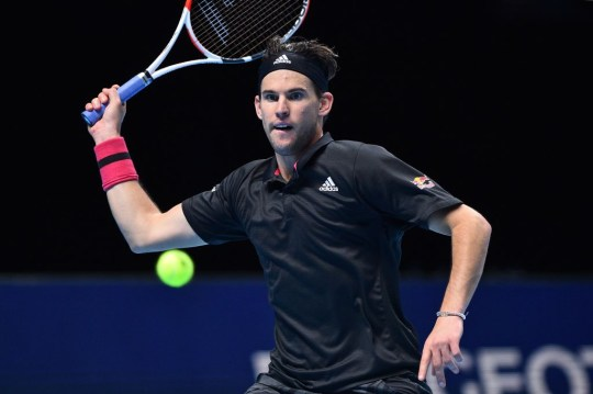 Austria's Dominic Thiem returns against Russia's Andrey Rublev in their men's singles round-robin match on day five of the ATP World Tour Finals tennis tournament at the O2 Arena in London on November 19, 2020.