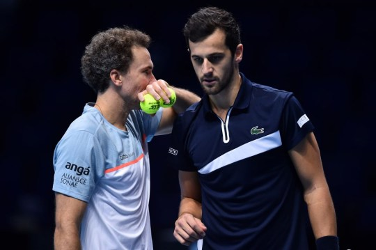 Brazil's Bruno Soares (L) and Croatia's Mate Pavic gesture while playing Australia's John Peers and New Zealand's Michael Venus in their men's doubles round-robin match on day six of the ATP World Tour Finals tennis tournament at the O2 Arena in London on November 20, 2020.