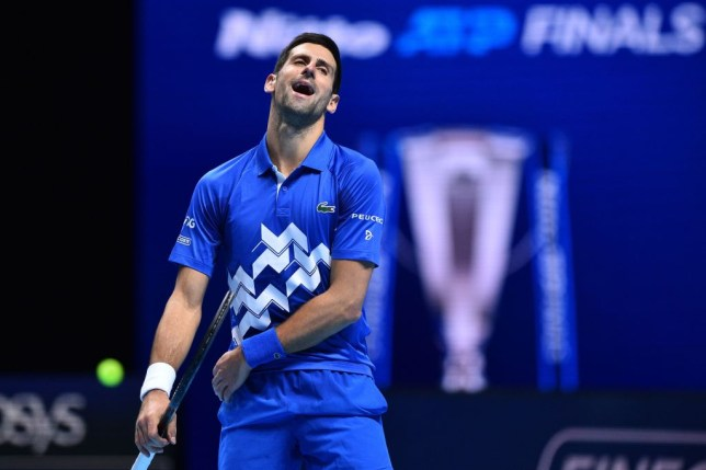 Serbia's Novak Djokovic reacts as he plays against Austria's Dominic Thiem during their men's singles semi-final match on day seven of the ATP World Tour Finals tennis tournament at the O2 Arena in London on November 21, 2020.