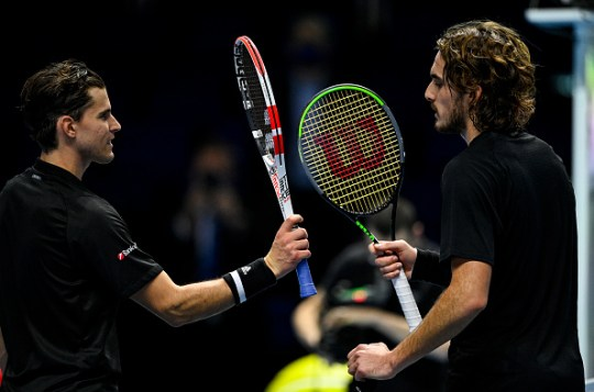 Dominic Thiem of Austria touches rackets with Stefanos Tsitsipas of Greece after beating him on Day 1 of the Nitto ATP World Tour Finals at The O2 Arena on November 15, 2020 in London, England.