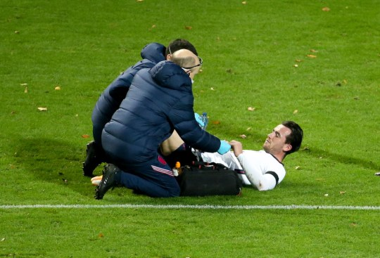 Ben Chilwell of England suffers an injury during the UEFA Nations League group stage match between Belgium (Red Devils) and England at King Power at Den Dreef Stadion on November 15, 2020 in Leuven, Louvain, Belgium.