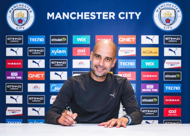 Pep Guardiola signs a new two-year contract at Manchester City