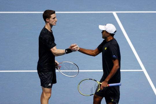 Rajeev Ram of The United States of America and Joe Salisbury of Great Britain celebrate match point and qualifying for the semi finals other during their doubles match against Kevin Krawietz of Germany and Andreas Mies of Germany during their third round robin match on Day Five of the Nitto ATP World Tour Finals at The O2 Arena on November 19, 2020 in London, England.
