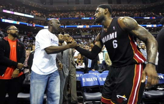 Charlotte Bobcats' team owner Michael Jordan shakes hands with Miami Heat forward LeBron James (6), after the Heat defeated the Bobcats, 109-98, in Game 4 of the NBA Eastern Conference quarterfinals at Time Warner Cable Arena in Charlotte, N.C., Monday, April 28, 2014. The Heat swept the series, 4-0.