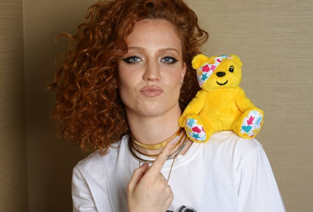 Jess Glynne poses with Pudsey Bear for Children in Need.
