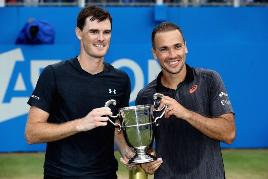 Jamie Murray of Great Britain and partner Bruno Soares of Brazil celebrate victory with the trophy following the mens doubles final against Julien Benneteau of France and Edourd Roger-Vasselin of France during day seven of the 2017 Aegon Championships at Queens Club on June 25, 2017 in London, England.