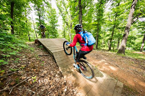 Mountain biker rides at Slaughter Pen in Bentonville, Arkansas
