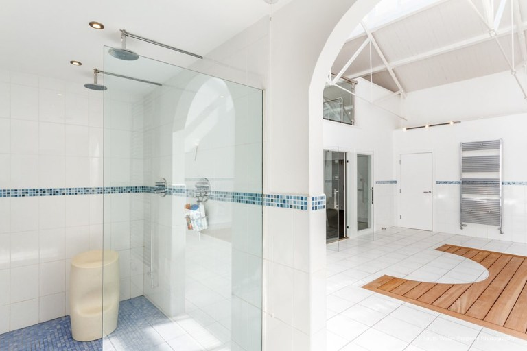 victorian municipal baths apartment on sale - shower in spa area