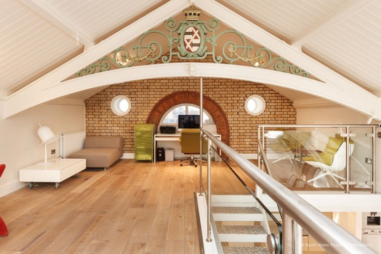 victorian municipal baths apartment on sale - home office on mezzanine level