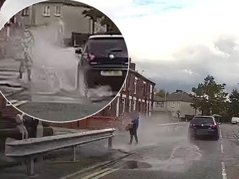 Moment driver 'deliberately drives into puddle' to splash boy