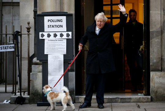 Britain's Prime Minister Boris Johnson leaves a polling station at the Methodist Central Hall, with his dog Dilyn, after voting in the general election in London, Britain, December 12, 2019. REUTERS/Henry Nicholls