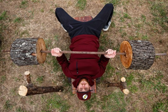 Adhering to Ohio's stay-at-home order due to the coronavirus outbreak, Zachary Skidmore bench presses as he lifts weights using his hand-made outdoor gym equipment on April 15, 2020 in Jackson, Ohio