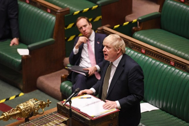 A handout photograph released by the UK Parliament shows Britain's Health Secretary Matt Hancock (L) listening to Britain's Prime Minister Boris Johnson during Prime Minister's Question time (PMQs) in the House of Commons in London on May 6, 2020, as parliament continues with social distancing measures in place, and some MPs taking part remotely by videolink, due to the novel coronavirus COVID-19 pandemic. - British Prime Minister Boris Johnson said Wednesday he could begin to ease a nationwide coronavirus lockdown next week, but warned he would do nothing that would risk a new surge of cases. He was speaking the day after Britain overtook Italy to become the worst-hit country in Europe, with more than 32,000 deaths related to COVID-19 -- behind only the United States in the global rankings. (Photo by JESSICA TAYLOR / various sources / AFP) / RESTRICTED TO EDITORIAL USE - NO USE FOR ENTERTAINMENT, SATIRICAL, ADVERTISING PURPOSES - MANDATORY CREDIT