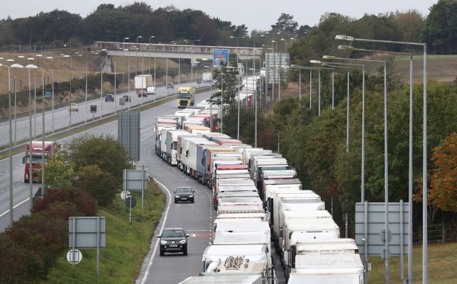 A view of lorries queuing on the M20 motorway for Eurotunnel in Folkestone, Kent, as the government develops the 27-acre site near Ashford into a post-Brexit lorry park as it gears up to leave the EU at the end of the year. PA Photo. Picture date: Friday September 25, 2020. Photo credit should read: Gareth Fuller/PA Wire